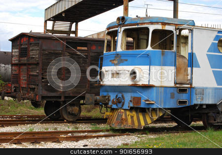 Old railway wagon and motor stock photo, Old abandoned railway wooden wagon and vintage rail-motor by Aleksandar Varbenov