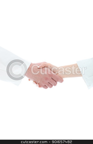 Handshake between medical staff stock photo, Cropped view of a male and female hand in white medical uniform sleeves clasped in a handshake conceptual of a greeting, success, thanks or agreement by Christine Langer-Pueschel
