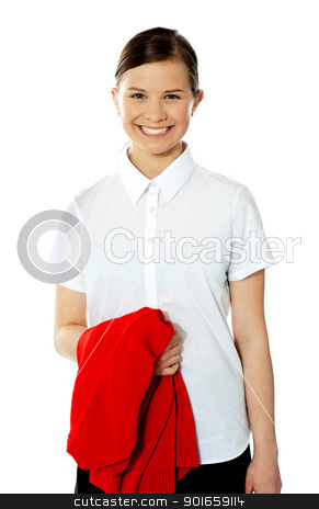 School girl holding her red sweater and smiling stock photo, School girl holding her red sweater and smiling, isolated on white background by Ishay Botbol