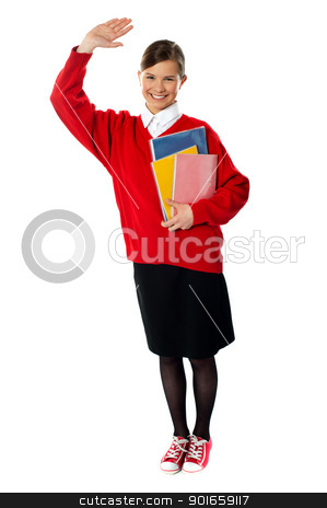 Full length view of student girl with giving hi5 stock photo, Full length view of student girl with giving hi5 and holding exercise books by Ishay Botbol