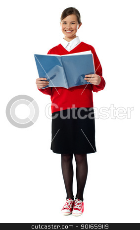 Smiling girl standing with exercise book stock photo, Caucasian smiling student girl standing with exercise book by Ishay Botbol