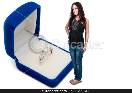 Woman and Wedding Ring stock photo, Beautiful woman standing next to a wedding ring in a jewelers box by Robert Byron