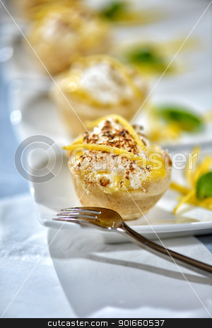 Lemon Meringue Tart stock photo, Image of lemon meringue tarts with garnish on white plates by Greg Blomberg