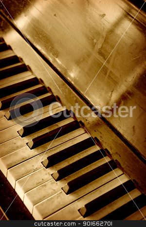 Old piano keyboard stock photo, Photo of an old dirty well-worn piano keyboard done in sepia.  by © Ron Sumners