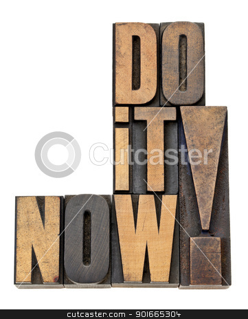 do it now motivation in wood type stock photo, do it now - motivation and encouragement - isolated phrase in vintage letterpress wood type by Marek Uliasz