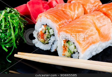 Roll made of salmon stock photo, Traditional japanese food roll made of salmon by Nanisimova