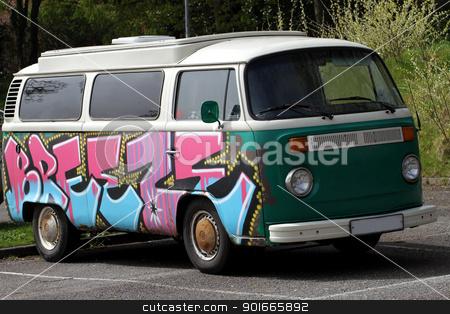 Hippie camper van stock photo, Retro German hippy camper van parked in countryside. by Martin Crowdy