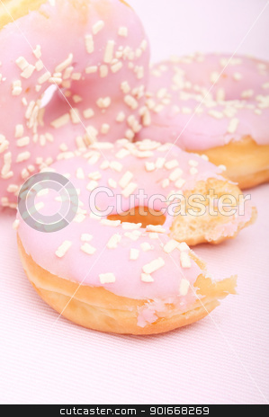 Donuts stock photo, Closeup of Homemade Donuts with Pink Icing - Shallow Depth of Field by JAMDesign