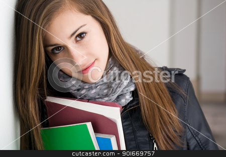 Shy young brunette student girl. stock photo, Closeup portrait of a shy young brunette student girl. by exvivo