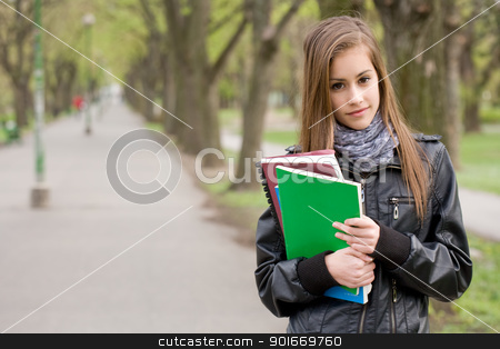 Fresh young student girl in the park. stock photo, Portrait of a fresh young student girl in the park holding exercise books. by exvivo