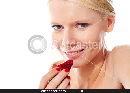 Closeup of young gorgeous girl holding strawberry stock photo, Smiling young gorgeous girl holding strawberry and looking at camera by Ishay Botbol
