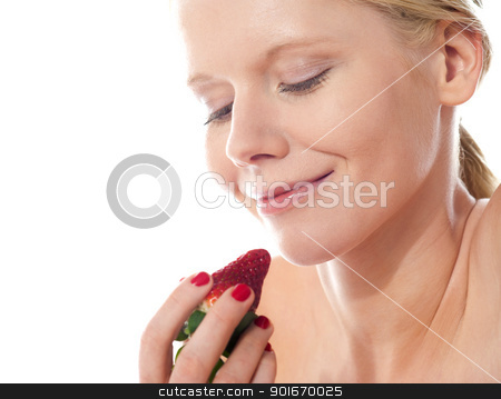 Young lady holding a strawberry stock photo, Attractive young lady holding a strawberry, about to eat by Ishay Botbol