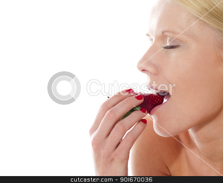 Young beautiful caucasian lady tasting yummy strawberry stock photo, Young beautiful caucasian lady tasting yummy strawberry, closeup shot by Ishay Botbol