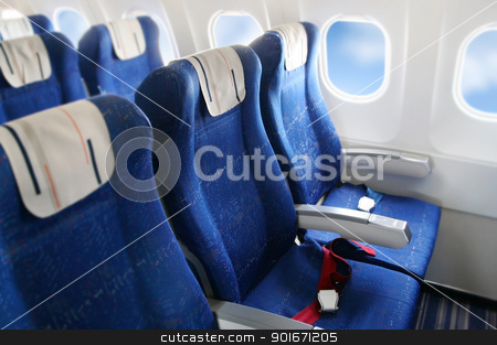 Airplane interior stock photo, seat rows in an airplane cabin by Laurent Davoust