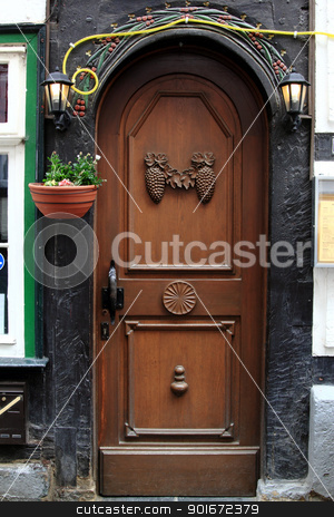 wooden door stock photo, wooden door of an old half timbered house by Torsten Lorenz
