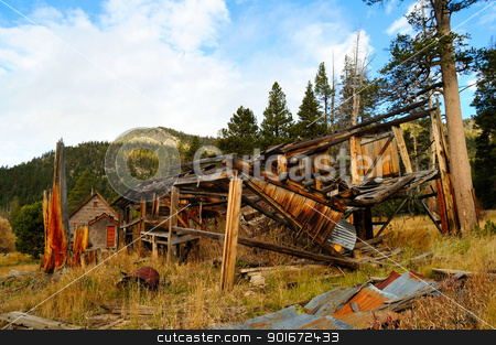 Old Colapsed Abandoned House stock photo, The decaying remains of an old abandoned home in the forest  located in the  California Sierra mountains. by Lynn Bendickson