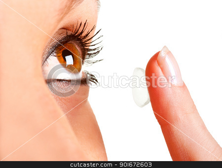 Contact Lens stock photo, Closeup of a woman inserting a contact lens in her eye by ruigsantos