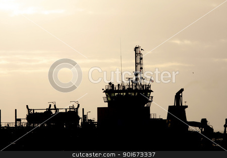 Silhouette of a ship stock photo, Silhouette of a ship against a sunset sky by steve ball
