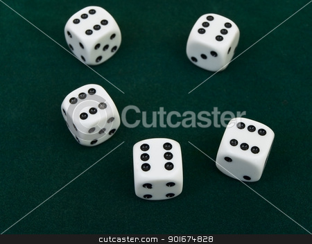 game cubes stock photo, five game cubes against the green background  by Sergej Razvodovskij