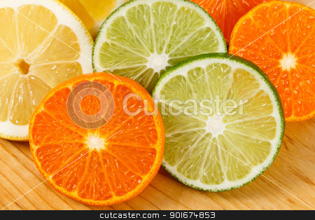 Sliced Citrus Fruit, Limes, Lemons and Oranges stock photo, Close up shot of fresh, juicy sliced limes, lemons and mandarin oranges by Karen Sarraga