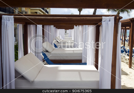 Luxury Daybed stock photo, A luxury day bed located on the beach by Kevin Tietz