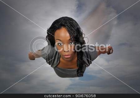 Beautiful Black Woman Flying stock photo, An extraordinarily beautiful young black woman with amazingly captivating eyes flies down out of the sky. by Carl Stewart