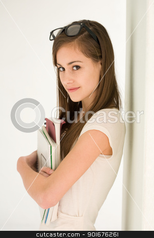 Attractive brunette student girl. stock photo, Portrait of an attractive young brunette teen student girl. by exvivo