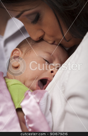 Attractive Ethnic Woman with Her Yawning Newborn Baby stock photo, Young Attractive Ethnic Woman Holding Her Yawning Newborn Baby. by Andy Dean