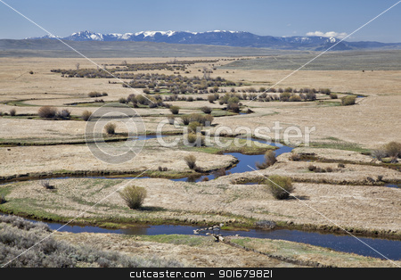 river meanders in North Park, Colorado stock photo, Illinois River meanders through Arapaho National Wildlife Refuge, North Park near Walden, Colorado, early spring scenery with some snow in distant mountains by Marek Uliasz