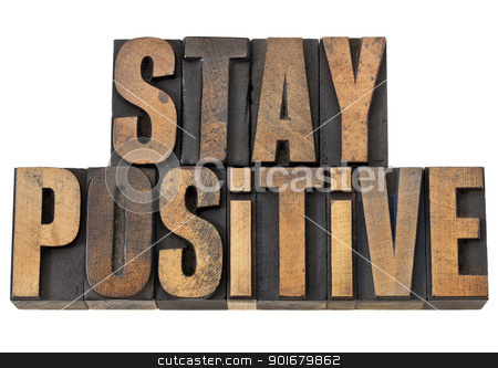 stay positive motivation phrase stock photo, stay positive - motivation concept - isolated text in vintage letterpress wood type by Marek Uliasz