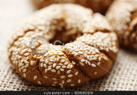 fresh wholegrain bread stock photo, fresh rustic bread/bagels, shallow dof by Liv Friis-Larsen