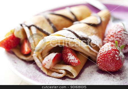 crepes stock photo, close up of two french style crepes, shallow dof. Some ingredients in the background by Liv Friis-Larsen