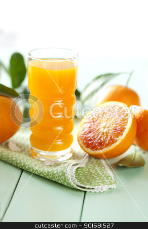 orange juice stock photo, freshly pressed orange juice by Liv Friis-Larsen