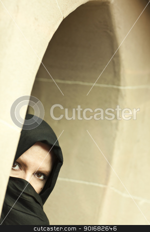 Cautious Islamic Woman in Window Pane Wearing Burqa or Niqab stock photo, Cautious Islamic Woman in a Window Pane Wearing Traditional Burqa or Niqab. by Andy Dean