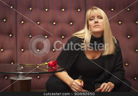 Sensual Blonde Woman Sitting Near Champagne and Rose stock photo, Sensual Beautiful Blonde Woman Sitting Near Champagne and Rose. by Andy Dean