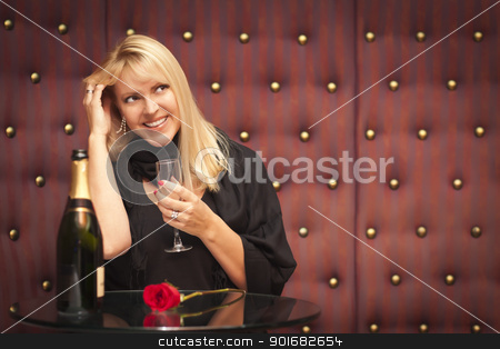 Sensual Blonde Woman Sitting Near Champagne and Rose stock photo, Sensual Smiling Beautiful Blonde Woman Sitting Near Champagne and Rose. by Andy Dean