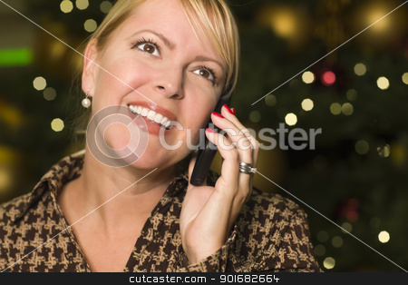 Blonde Woman On Her Cell Phone in the City Lights stock photo, Beautiful Blonde Woman On Her Cell Phone in the City Lights. by Andy Dean