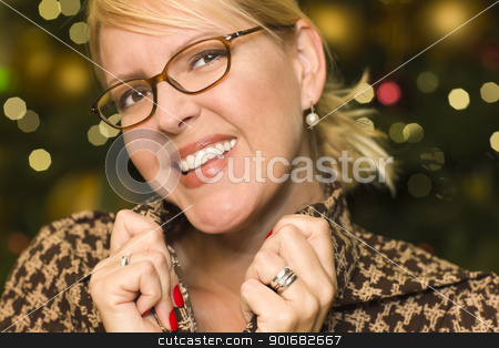 Blonde Woman Wearing Glasses in the City Lights stock photo, Beautiful Blonde Woman Smiling Wearing Glasses in the City Lights. by Andy Dean