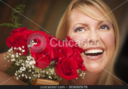 Smiling Blonde Woman with Red Roses stock photo, Beautiful Smiling Blonde Woman with Red Roses. by Andy Dean