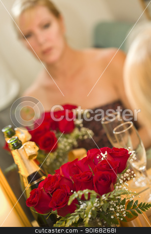 Pensive Blonde Sits at Mirror Near Champagne and Roses stock photo, Attractive Pensive Blonde Sits at Mirror Near Champagne and Roses. by Andy Dean