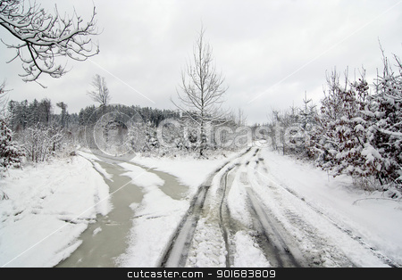 crossroad in winter stock photo, Shot of the snowy winter landscape with dirt road by Siloto
