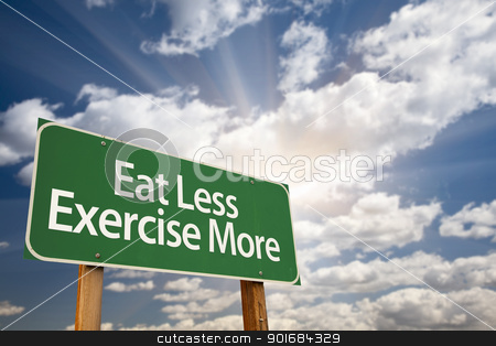 Eat Less Exercise More Green Road Sign and Clouds stock photo, Eat Less Exercise More Green Road Sign with Dramatic Clouds, Sun Rays and Sky. by Andy Dean