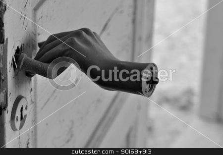 horror hand stock photo, Detached doll hand pulling old door handle in haunted house. by sirylok