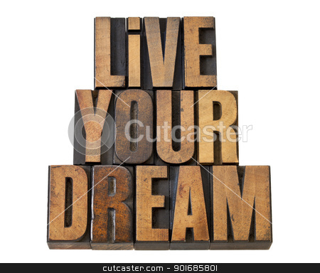 live your dream in wood type stock photo, live your dream - motivation reminder - isolated text in vintage letterpress wood type by Marek Uliasz