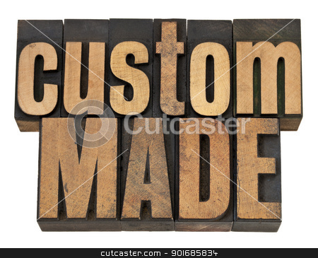 custom made in wood type stock photo, custom made - isolated text in vintage letterpress wood type by Marek Uliasz