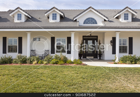 Newly Constructed Modern House Facade stock photo, Beautiful Modern House Facade Against a Blue Sky. by Andy Dean