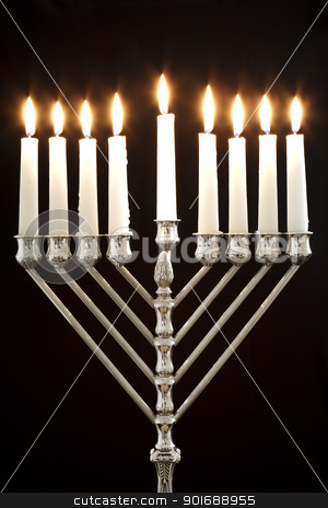 Hanukkah Menorah / Hanukkah Candles stock photo, Silver Hanukkah candles all candle lite on the traditional Hanukkah menorah on a black background by Dmitry Pistrov