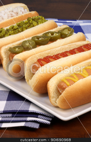 hot dogs  stock photo, hot dogs on a nice table setting rich textures colors and flavors     by Raul Taborda
