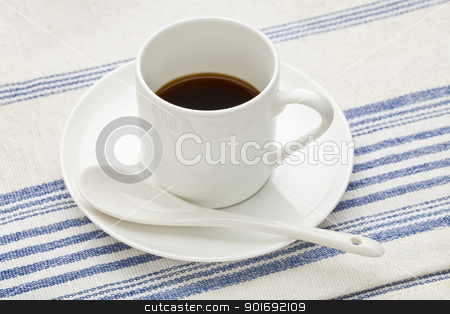 espresso coffee cup with spoon stock photo, a white china cup of espresso coffee with a ceramic spoon against cotton tablecloth by Marek Uliasz