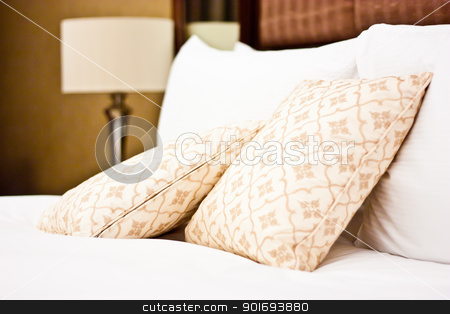 Pillows in Hotel bedroom stock photo, Concept for luxury and Honeymoon, pillows in a luxury hotel by Perseomedusa
